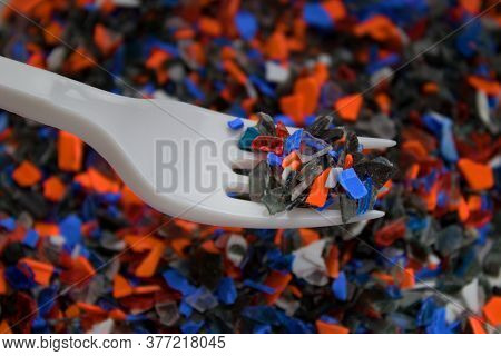 Crushed Recycled Plastic And Fork . Plastic For Further Processing.recycle! Cleaning Up Nature Is Ex