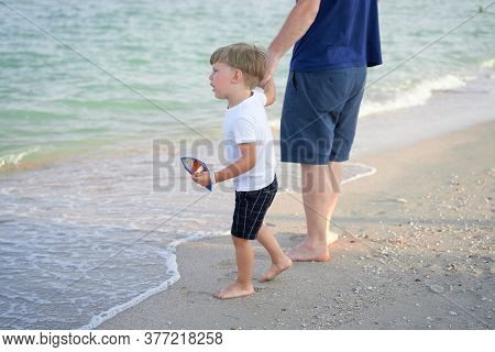 Dad Holds Son Hand. Father Child Spending Time Together Sea Vacation Young Man Little Boy Walking Be
