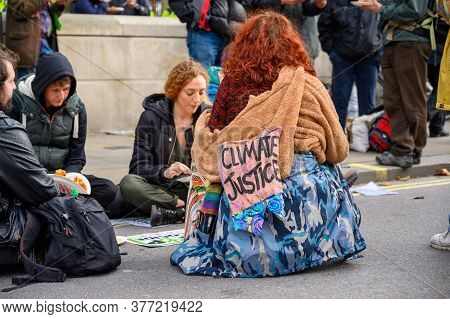 London - October 18, 2019: Climate Justice Extinction Rebellion Protester At A Sit In Outside Of Dow