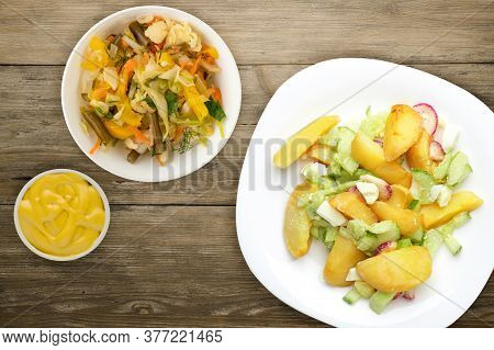 Potato Wedges With Vegetables On A White Plate On A Wooden Background. Unhealthy Food . Rustic Food.