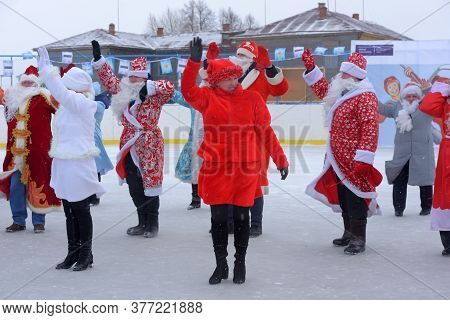 Many Santa Clauses And Snow Maidens Dance Together, A Flash Mob