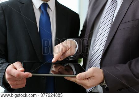 Cropped Head Of Men In Classic Suits And Ties Are Discussing Work While Using Touchpad