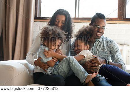 Playful Biracial Parents Play Tickle Little Kids