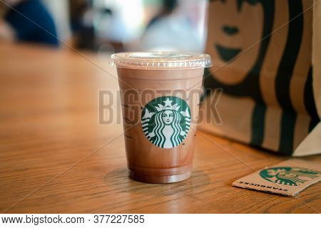 Samut Prakan, Thailand - July 20, 2020 : Glass Of Starbuck Coffee Iced Mocha Served On Wood Table In