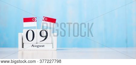 Wooden Calendar Of August 9th With Miniature Singapore Flags. Singapore's Independence Day, City-sta