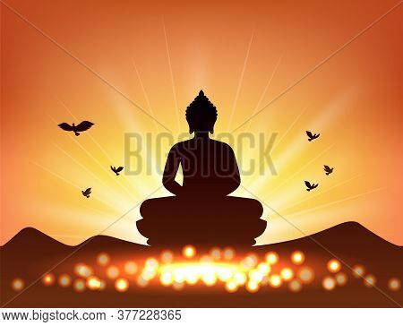 Buddha Silhouette In Sunset Sky And Candlelight For Buddhism