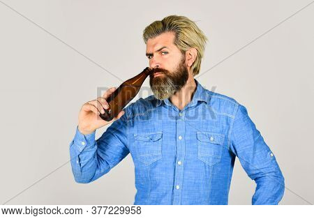 Male Holding Bottle Of Beer. Hipster Rest In Pub. Sports Lover Cheer Up. Mature Man Holding Glass Bo