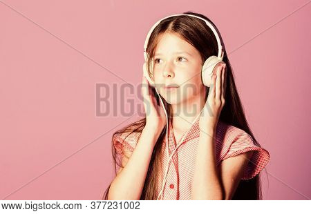 Useful Information. Home Schooling. Small Girl Pupil In Headphones. Child Study Online. E Learning W