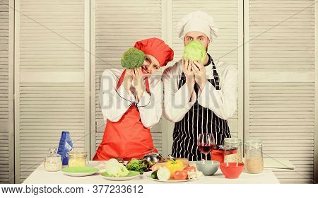 Couple Cooking Healthy Vegetarian Meal. Vegetarian Family. Vegetarian Nutrition And Vegetable Diet.