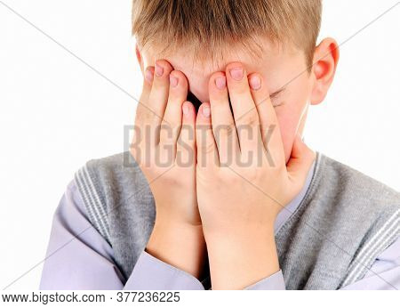 Sorrowful Young Boy Close His Face Isolated On The White Background