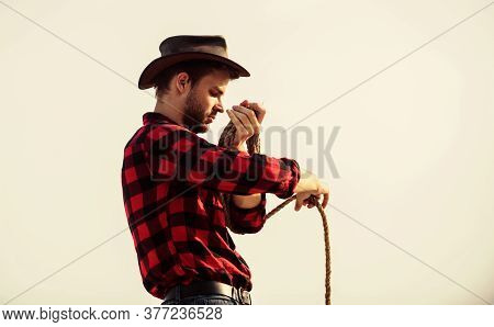 Old West. Man Checkered Shirt On Ranch. Wild West Rodeo. Thoughtful Man In Hat. Cowboy With Lasso Ro