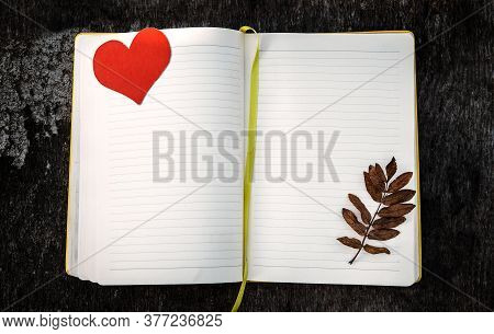 Blank Writing Pad With Red Heart Shape And Autumnal Leaf On The Grunge Background