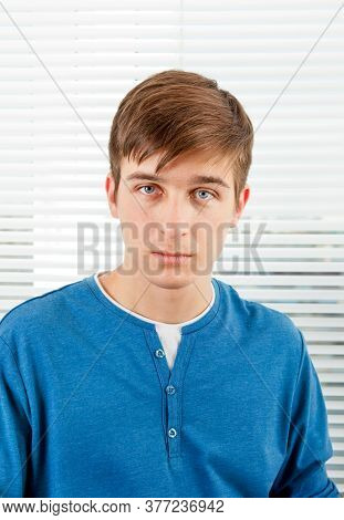 Young Man Portrait On The Jalousie Background