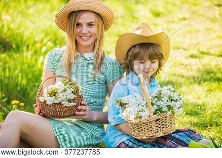 Motherhood Happiness. Cowboy Family Collecting Flowers In Baskets. Wildflowers In Field. Happy Holid