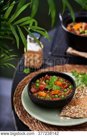 Spanish Pardina Lentil And Chorizo Stew With Vegetables On A Table. Selective Focus, Space For Text.