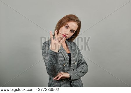 Showing Four 4 Fingers Hand Gesture, Show The Number Three With Hands, Pointing Up Arm While Smiling