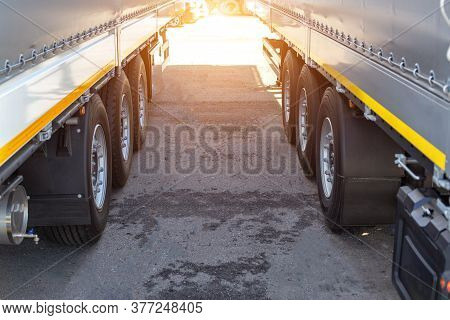 Two New Truck Semi-trailers Are Parked In A Truck Stop. Cargo Transportation Concept Axle Load, Over