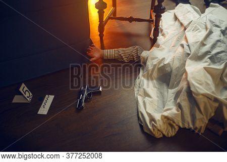 Dead man, victim and murder weapon, crime scene
