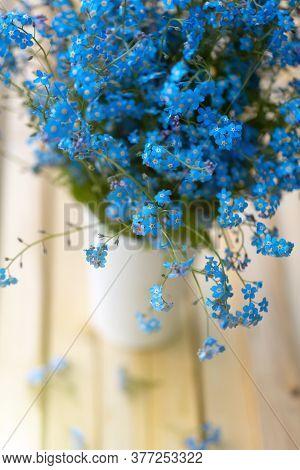 Forget-me-nots Flowers In A Vase. Blue Flowers Bouquet. Beautiful Floral Romantic Background. Festiv