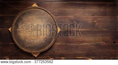 table cloth napkin and pizza cutting board on wooden background texture