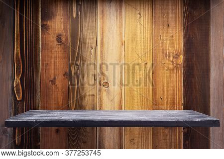 wooden book shelf at board plank background surface texture, front view