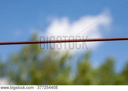 Clothesline Rope Agains Blue Sky. Close Up View