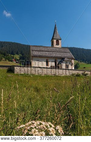 South Tyrolean Mountain Church Under A Blue Sky With A Single White Cloud, Mountain Landscape With M