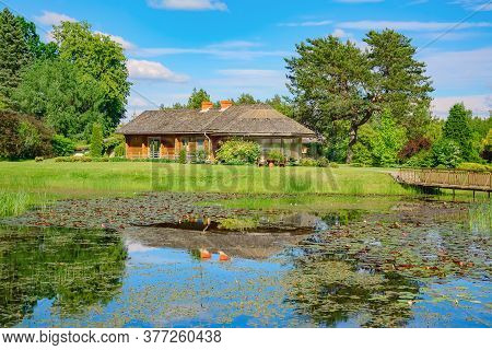 House Near The Pond In The Rural Area
