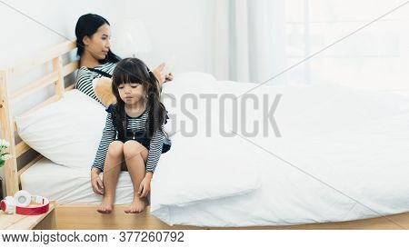 Sad Unhappy Young Daughter Upset While Mother Ignores And Keeps Playing Mobile Phone, Mother-daughte
