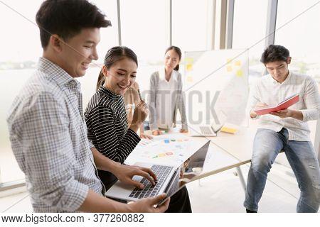Scene Of An Asian Entrepreneur Group Having An Intense Business Meeting, The Concept Of Teamwork, Br