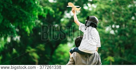 Panoramic Background Of Father And Son On His Shoulder Playing Paper Plane, Spending Time Together A