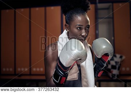 Woman with the boxing gloves.Sport concept. boxing young african-american girl.