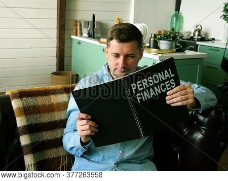 Man Reads About Personal Finances. Financial Literacy Concept.