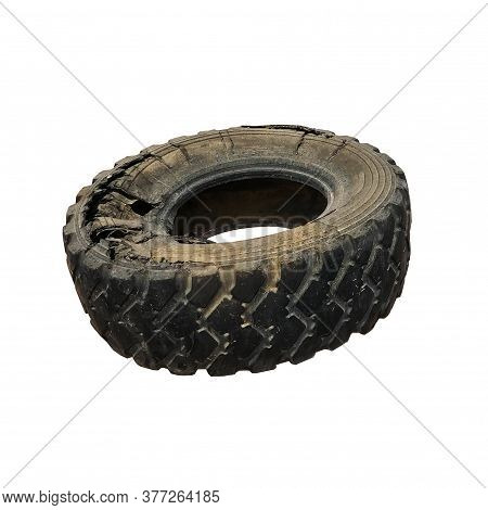 Isolated From The Background Tire Wheel Suddenly Broke, Side, Black Tire With Tread And Holes, Part
