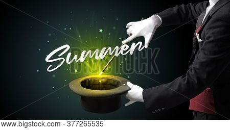 Magician is showing magic trick with Summer inscription, traveling concept