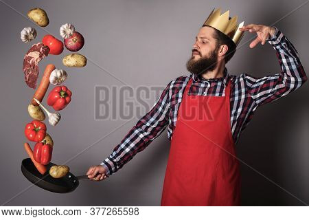 Cooking Man Concept, King Of Kitchen,bearded Man In Checked Shirt, Drop Up Meat And Vegetables From
