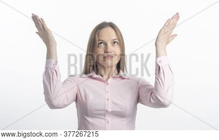 Smiling Glad Young Caucasian Woman Showing At Top With Both Hands Open Palms, Presenting, Advertisin