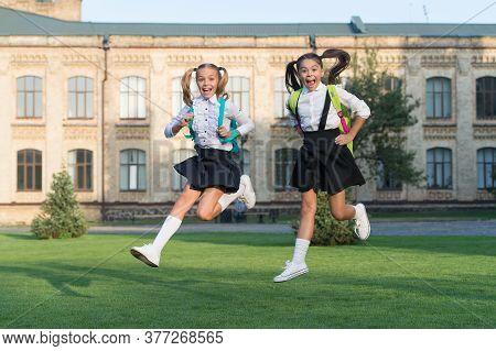 Excited Happy Girls School Uniform Running, September Reunion Concept.