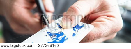 Close-up Of Expired Credit Card, Person Cutting Plastic Object With Scissors. Limited Payment O R Ov