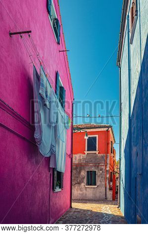 Burano Island Narrow Cobblestone Street Between Colorful Houses Buildings With Multicolored Walls An
