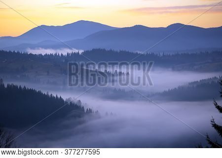 Morning Fog. Morning Landscape In The Mountains. Dawn In The Mountains. The Morning Sun In The Fog.