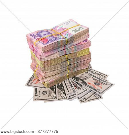 Hryvnia Lies On Dollars. Inflation, Exchange Rate. Bundles Of Money Tied With An Elastic Band. Ukrai