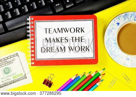 Teamwork Makes The Dream Work - A Text Message In A Notepad On The Computer Keyboard. The Business P