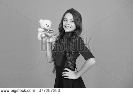 Emotional Intellect. Lovely Child. Childhood Concept. Lovely Small Girl Smiling Happy Face Hold Toy.