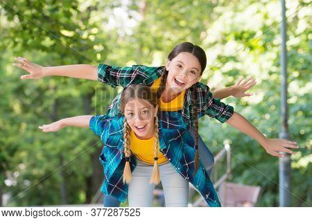 Fly With Me. Portrait Of Happy Sisters. Little Kids Girls In Shirt. Two Young Funny Hipster Girls In