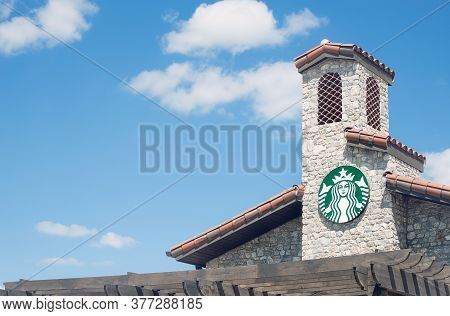 Westlake, Texas - July 18, 2020: Starbucks Coffee House Sign On The Top Of The Store In A New Upscal
