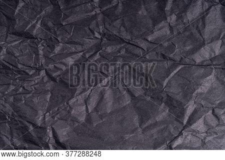 Dark Wrinkled Creased Black Paper Poster Texture. Blank Creased Crumpled Grainy Paper Textured Surfa