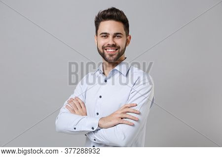 Smiling Successful Young Unshaven Business Man In Light Shirt Posing Isolated On Grey Background Stu
