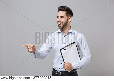 Cheerful Young Unshaven Business Man In Light Shirt Isolated On Grey Background. Achievement Career