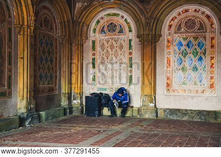 New York, Usa - February 8, 2020: Homeless Man With His Belongings And Bags Sitting In Historic Beth